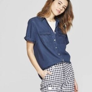Button up short sleeved chambray shirt.